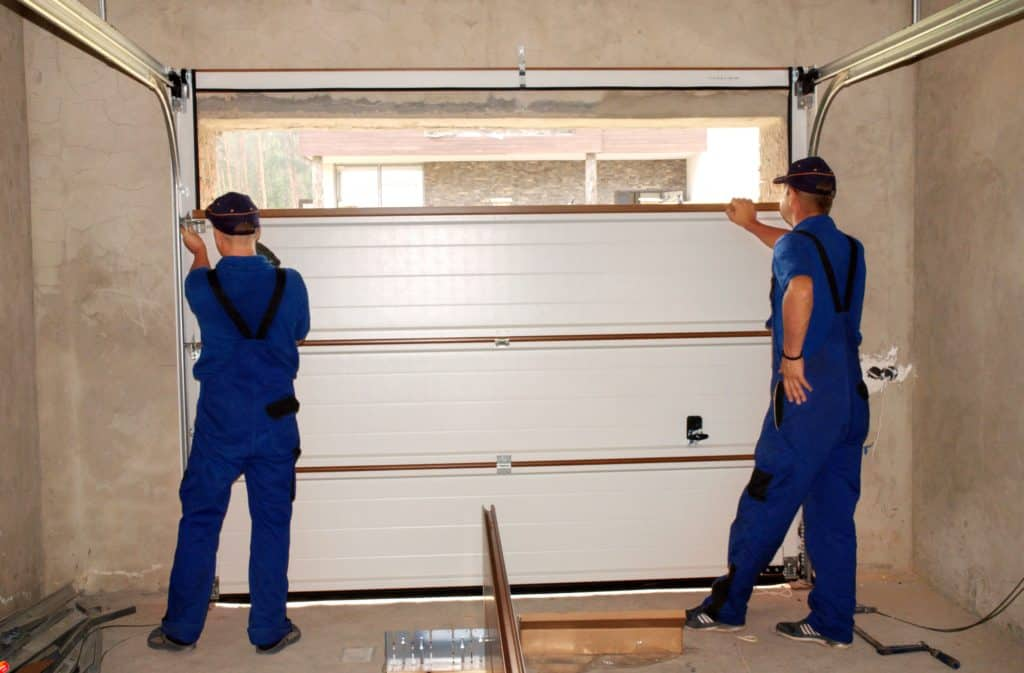 before buying a replacement garage door